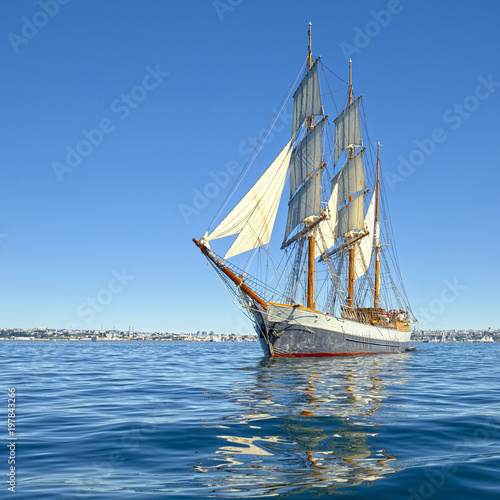 Beautiful sailing ship in the blue sea under sail. Yachting. Sailing