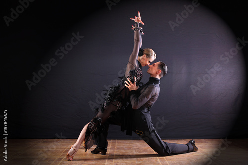plakat dancers in ballroom isolated on black background