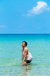 The man is fun and enjoy swimmimg or playing in the clear sea and blue sky background inthe sunny day ,Thailand.
