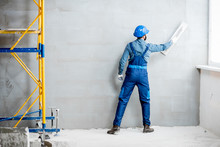 Plasterer In Blue Working Unif...
