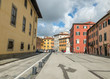 PISA, ITALY - MARCH 8, 2018: Piazza Carrara with colorful buildings. Pisa attracts 3 million tourists annually