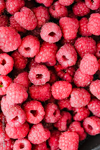 Stickers pour porte Pierre, Sable Heap of sweet red raspberry and basil close up. Fresh berry.Top view..Detox diet food and raw vegan concept.