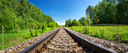 Railway outdoors on beautiful summer day. Landscape with railroad