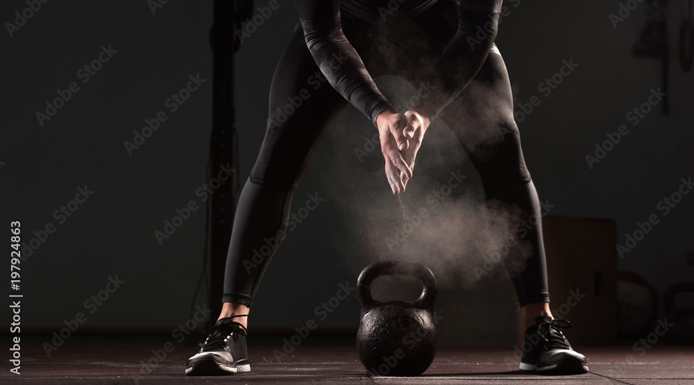 Fototapety, obrazy: Athletic young man working out in gym. Muscular male adult exercising with kettle bells, functional or cross training. Fitness and sports concept.