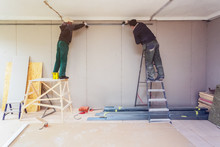 Workers Are Installing Plaster...