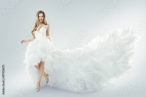 Fotografija  Woman Flying White Dress, Elegant Fashion Model Fluttering Gown Train, Young Gir