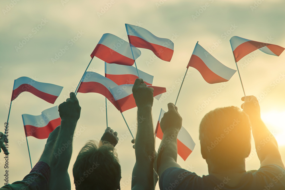 Fototapety, obrazy: Poland patriots, back view. People raising polish flags up to the sky.