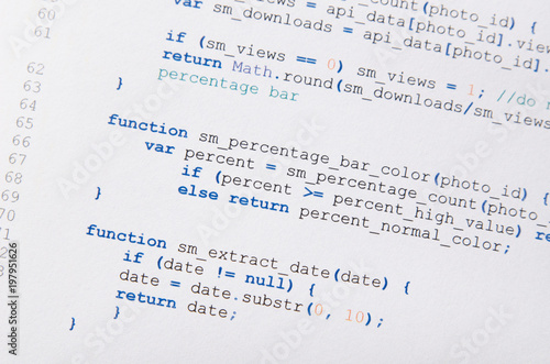Photo  Web developer programming code printed on a piece of paper
