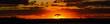 canvas print picture - savannah sunset behind tree orange sky