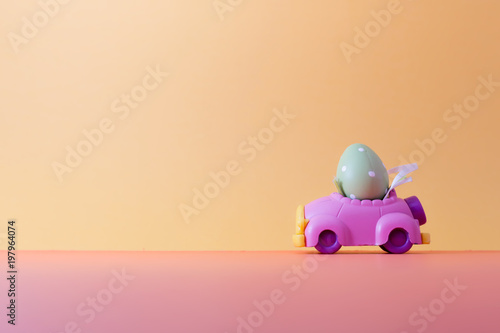 Easter egg on car with copy space for texts Fototapeta