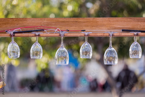 Wine glasses hanging on the planks.