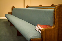 Empty Pews With Stacked Books