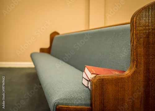 Fotografering Empty pews with stacked books