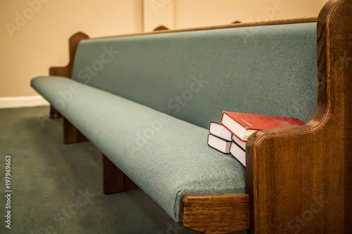 Valokuva  Empty pews with stacked books