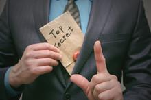 Top Secret Concept. Top Secret Documents Or Message In Businessman Hands. Confidential Dossier Information. Super Important Information.