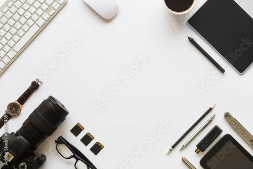 Fototapeta White desk office with laptop, smartphone and other supplies with cup of coffee. Top view with copy space for input the text. Designer workspace on desk top, view with essential elements on flat lay.. obraz na płótnie