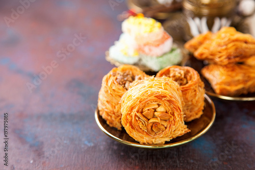 Traditional arabic desserts Kunafa and Baklava with honey and nuts Canvas Print
