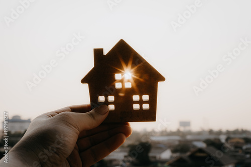 House model in home insurance broker agent 's hand or in salesman person Wallpaper Mural