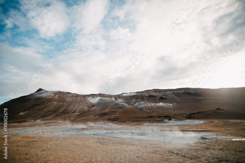 Poster Marron chocolat majestic landscape with hills and hot spring with steam in iceland