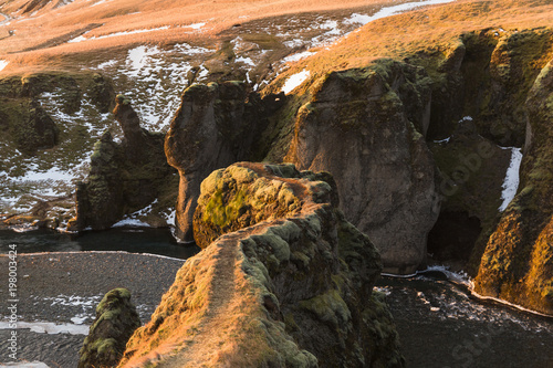 Stickers pour porte Pierre, Sable majestic natural view of small river, rocks and snow in iceland
