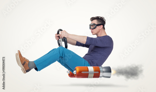 Fotografía  Funny man in goggles car driver with a wheel, concept of alternative transport