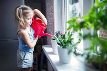 Little Girl Is Watering Flower...