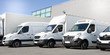 canvas print picture - delivery white vans in service van trucks and cars in front of the entrance of a warehouse distribution logistic society