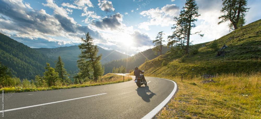 Fototapety, obrazy: Motorcycle driver riding in Alpine highway, Nockalmstrasse, Austria, Europe.