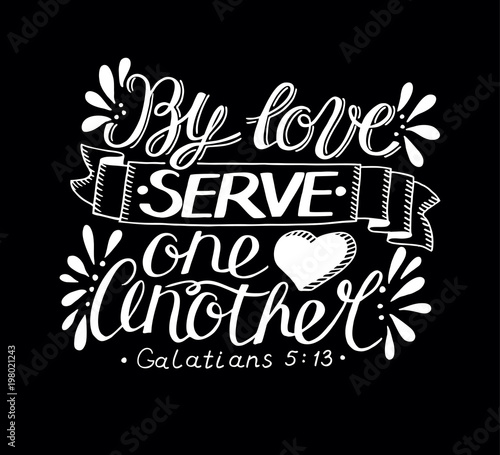 Fotografia, Obraz Hand lettering with bible verse By love serve one another made on black background