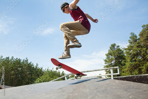 teenagerr jumping on skateboard
