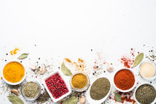 Various Spices In A Bowls On W...
