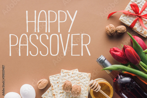 Top view of happy passover greeting and matza on brown passover top view of happy passover greeting and matza on brown passover tale concept m4hsunfo