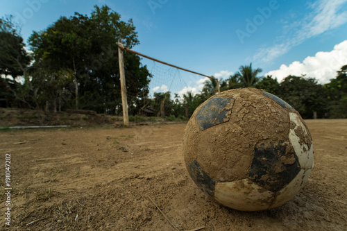 close up old football on ground at a dirt pitch Canvas-taulu
