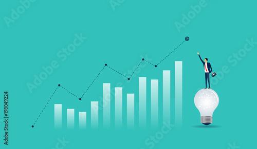 Cuadros en Lienzo flat businessman standing on light bulb with  business  finance  graph concept