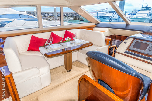 Luxury lunch table setting on a yacht interior comfortable design for holiday recreation tourism travel and vacation concept