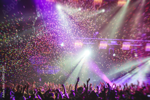 A crowded concert hall with scene stage lights, rock show performance, with peop Fototapeta