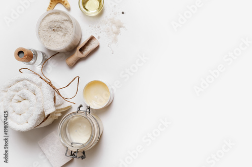 Keuken foto achterwand Spa Spa cosmetic background. Treatment products on white paper background. Space for text. Flat lay. Top view.