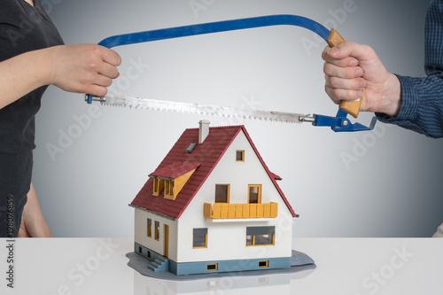 Cuadros en Lienzo  Divorce and dividing a house concept