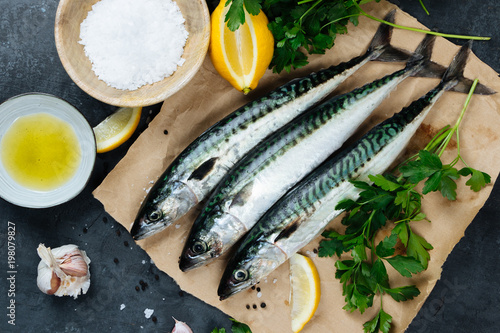 Foto op Canvas Vis Fresh mackerel fish with ingredients to cook