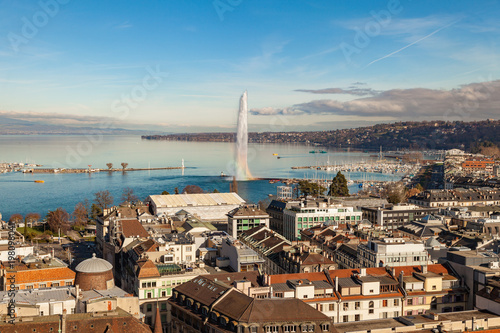 Foto op Aluminium Diepbruine Geneva water jet fountain with rainbow. Geneva aerial view from St. Pierre Cathedral bell tower. Winter day in Geneva, Switzerland.