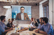 canvas print picture - Business people looking at projector during video conference in office