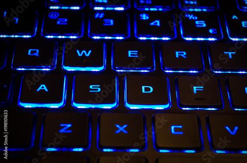 Photo  Blue keyboard backlight of gaming computer