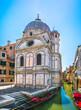 Venice church Santa Maria dei Miracoli, gondolas and water canal. Italy.