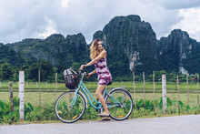 Pretty Woman On Bicycle On Rur...