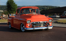 Old American Chevrolet Pickup Truck On The Road. Vintage Car Orange Truck  - Retro Style.
