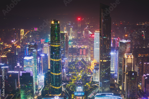 Tuinposter China Beautiful wide-angle night aerial view of Guangzhou Zhujiang New Town financial district, Guangdong, China with skyline and scenery beyond the city, seen from the observation deck of Canton Tower