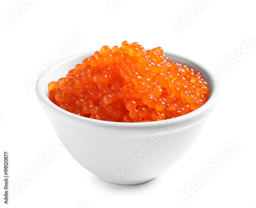 Bowl with delicious red caviar on white background