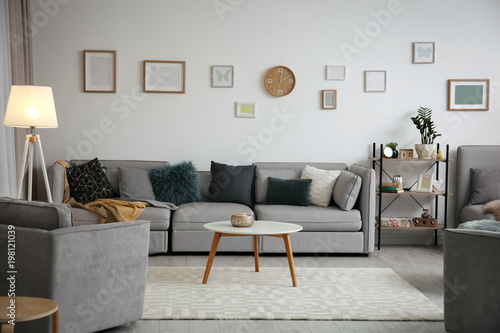 Fotografía  Modern living room interior with comfortable sofa and small table