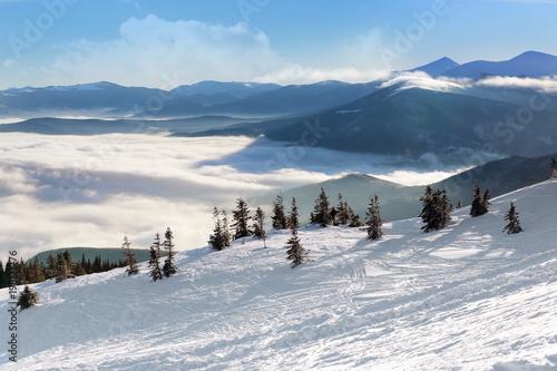 Ski slope at snowy resort on winter day
