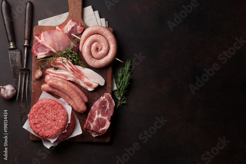Staande foto Vlees Raw meat and sausages
